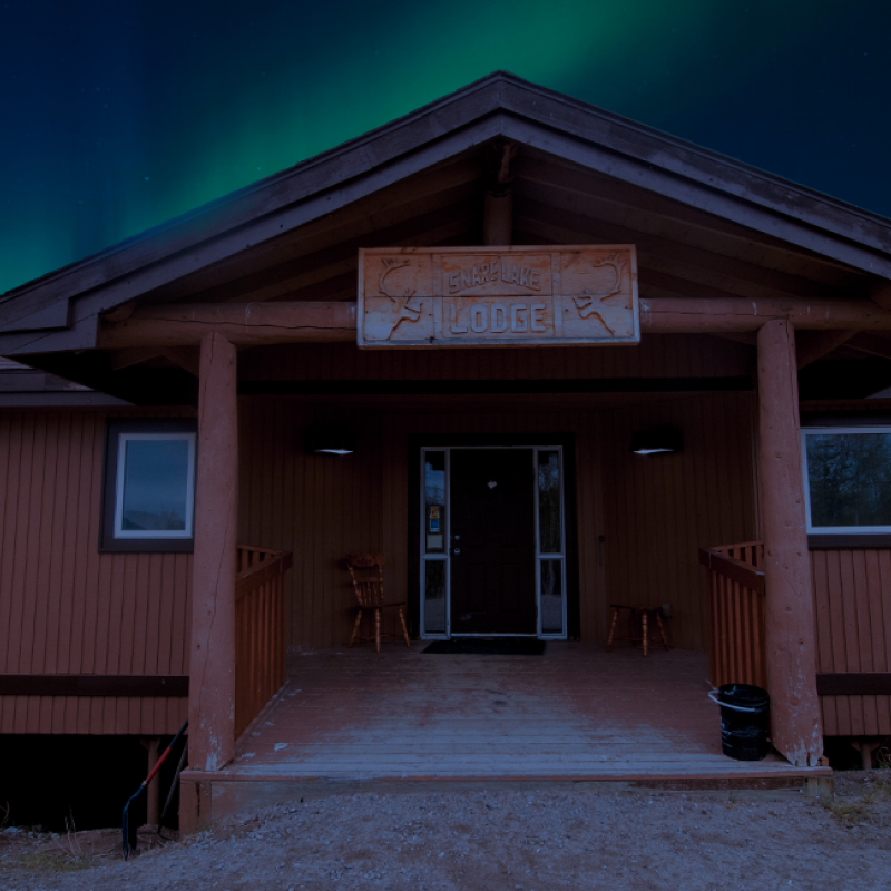 Snare Lake Lodge with Northern Lights at top